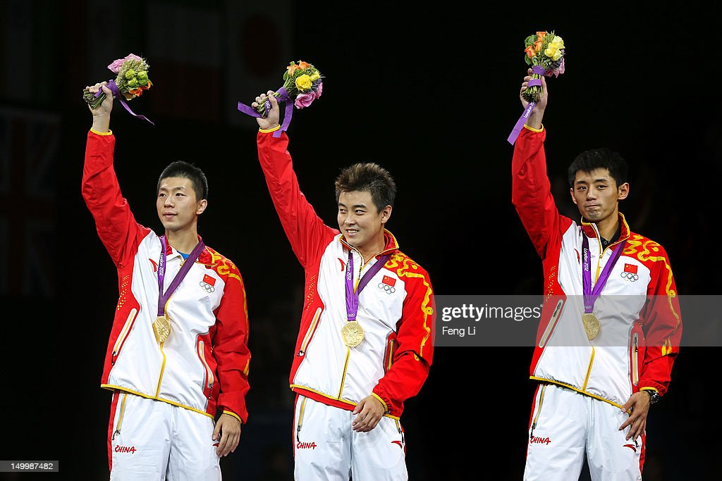 Gold medalists Ma Long, Wang Hao and Zhang Jike celebrate on the podium during the medal ceremony for the Men's Team Table Tennis on Day 12 of the London 2012 Olympic Games at ExCeL on August 8, 2012 in London, England.