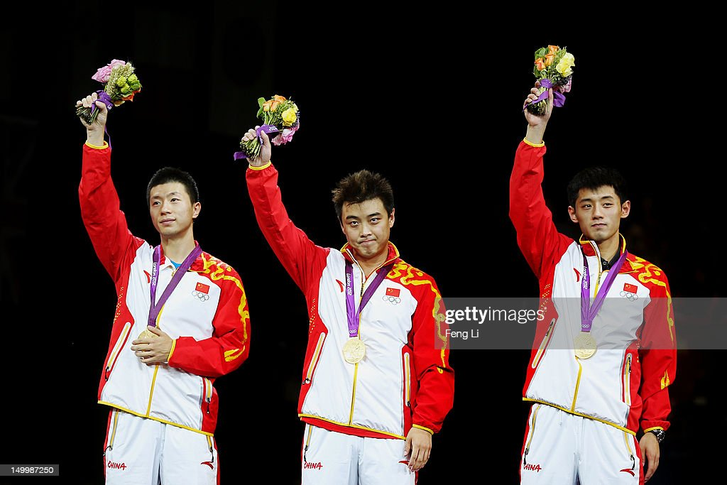 Gold medalists Ma Long, Wang Hao and Zhang Jike of China celebrate on the podium during the medal ceremony for the Men's Team Table Tennis on Day 12 of the London 2012 Olympic Games at ExCeL on August 8, 2012 in London, England.