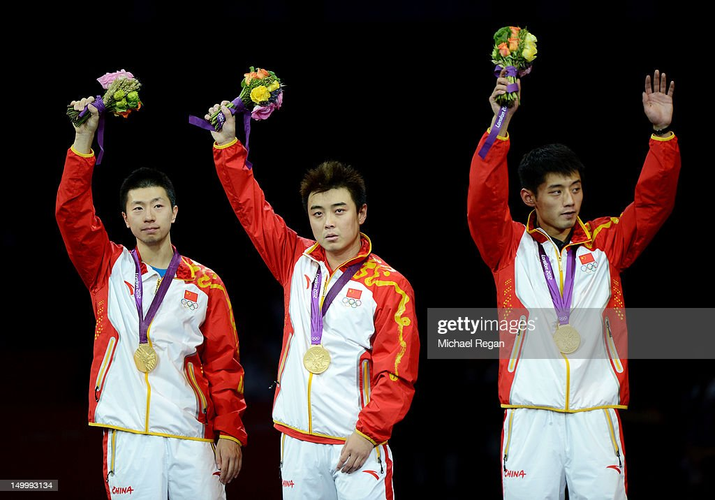 Gold medalists <a gi-track='captionPersonalityLinkClicked' href=/galleries/search?phrase=Ma+Long+-+Table+Tennis+Player&family=editorial&specificpeople=2158981 ng-click='$event.stopPropagation()'>Ma Long</a>, Wang Hao and <a gi-track='captionPersonalityLinkClicked' href=/galleries/search?phrase=Zhang+Jike&family=editorial&specificpeople=4979400 ng-click='$event.stopPropagation()'>Zhang Jike</a> of China celebrate on the podium during the medal ceremony for the Men's Team Table Tennis on Day 12 of the London 2012 Olympic Games at ExCeL on August 8, 2012 in London, England.
