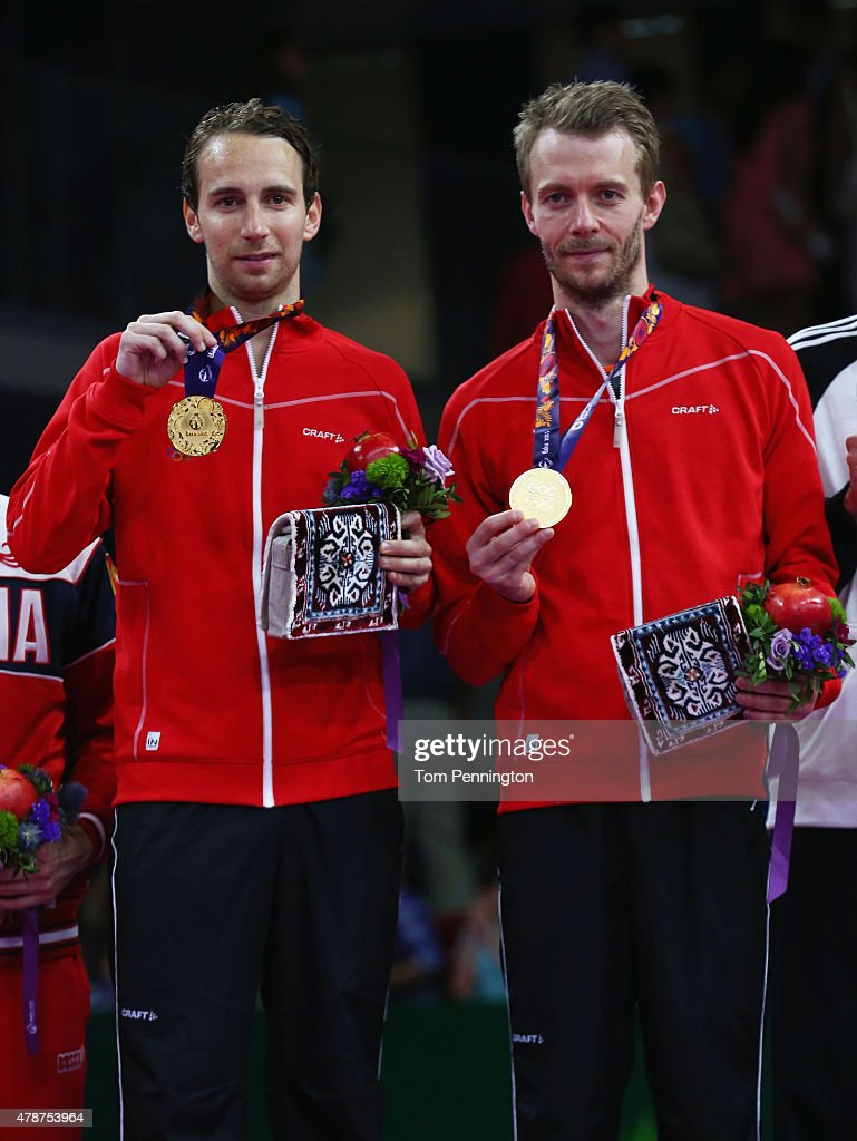 Gold medalists <a gi-track='captionPersonalityLinkClicked' href=/galleries/search?phrase=Mathias+Boe&family=editorial&specificpeople=651077 ng-click='$event.stopPropagation()'>Mathias Boe</a> (L) and <a gi-track='captionPersonalityLinkClicked' href=/galleries/search?phrase=Carsten+Mogensen&family=editorial&specificpeople=651076 ng-click='$event.stopPropagation()'>Carsten Mogensen</a> of Denmark stand on the podium during the medal ceremony for the Men's Badminton Doubles on day fifteen of the Baku 2015 European Games at at Baku Sports Hall on June 27, 2015 in Baku, Azerbaijan.