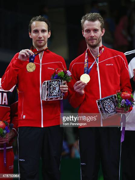 Gold medalists Mathias Boe and Carsten Mogensen of Denmark stand on the podium during the medal ceremony for the Men's Badminton Doubles on day...
