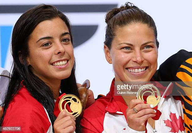 Gold medalists Meaghan Benfeito and Roseline Filion of Canada pose during the medal ceremony for the Women's Synchronised 10m Platform Final at Royal...