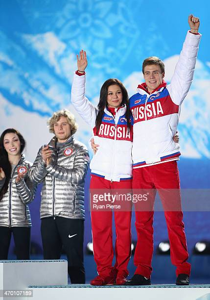 Gold medalists Meryl Davis and Charlie White of the United States and bronze medalists Elena Ilinykh and Nikita Katsalapov of Russia celebrate on the...