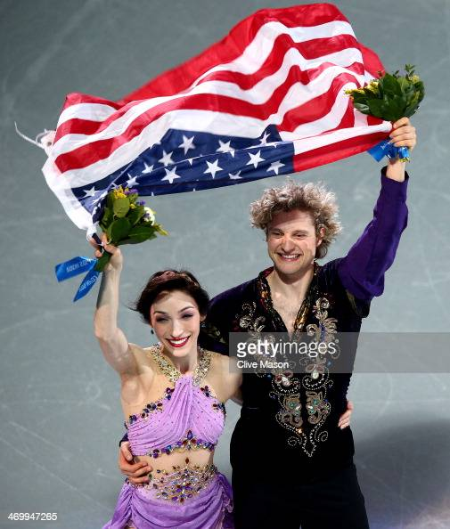 Gold medalists Meryl Davis and Charlie White of the United States celebrate during the flower ceremony for the Figure Skating Ice Dance on Day 10 of...