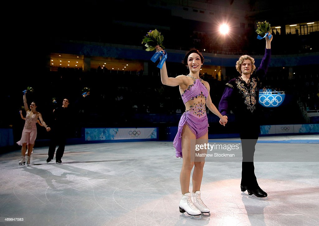 Gold medalists <a gi-track='captionPersonalityLinkClicked' href=/galleries/search?phrase=Meryl+Davis&family=editorial&specificpeople=3995758 ng-click='$event.stopPropagation()'>Meryl Davis</a> and Charlie White of the United States celebrate during the flower ceremony for the Figure Skating Ice Dance on Day 10 of the Sochi 2014 Winter Olympics at Iceberg Skating Palace on February 17, 2014 in Sochi, Russia.