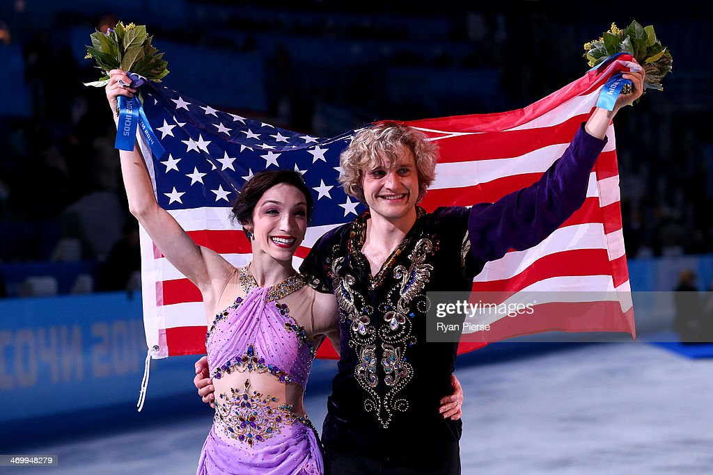 Gold medalists Meryl Davis and Charlie White of the United States celebrate during the flower ceremony for the Figure Skating Ice Dance on Day 10 of the Sochi 2014 Winter Olympics at Iceberg Skating Palace on February 17, 2014 in Sochi, Russia.