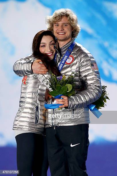 Gold medalists Meryl Davis and Charlie White of the United States celebrate during the medal ceremony for the Figure Skating Ice Danceon day 11 of...