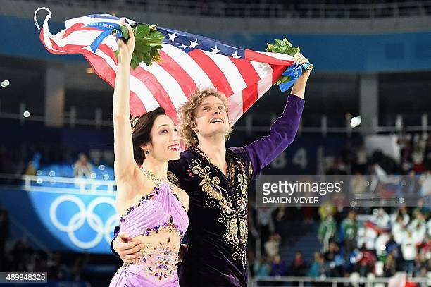 US gold medalists Meryl Davis and Charlie White pose during the Figure Skating Ice Dance Flower Ceremony at the Iceberg Skating Palace during the...