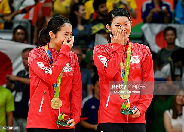 Gold medalists Misaki Matsutomo and Ayaka Takahashi of Japan celebrate on the podium during the medal ceremony for the Women's Doubles on Day 13 of...