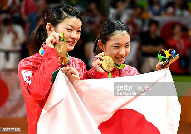 Gold medalists Misaki Matsutomo and Ayaka Takahashi of Japan pose for photographs after the medal ceremony for the Women's Doubles on Day 13 of the...