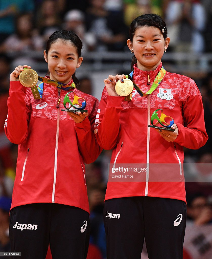 Gold medalists Misaki Matsutomo and Ayaka Takahashi of Japan pose on the podium during the medal ceremony for the Women's Doubles Badminton on Day 13 of the Rio 2016 Olympic Games at Riocentro - Pavilion 4 on August 18, 2016 in Rio de Janeiro, Brazil.