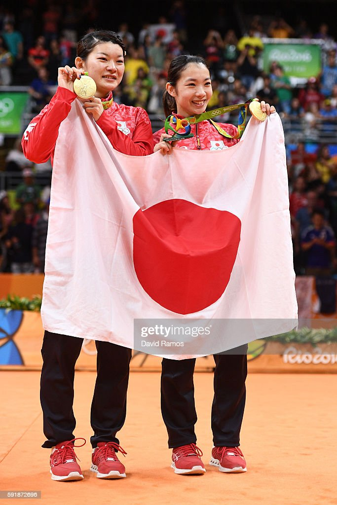 Gold medalists Misaki Matsutomo and Ayaka Takahashi of Japan pose during the medal ceremony for the Women's Doubles Badminton on Day 13 of the Rio 2016 Olympic Games at Riocentro - Pavilion 4 on August 18, 2016 in Rio de Janeiro, Brazil.