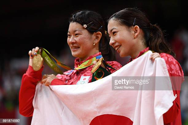 Gold medalists Misaki Matsutomo and Ayaka Takahashi of Japan pose during the medal ceremony for the Women's Doubles Badminton on Day 13 of the Rio...