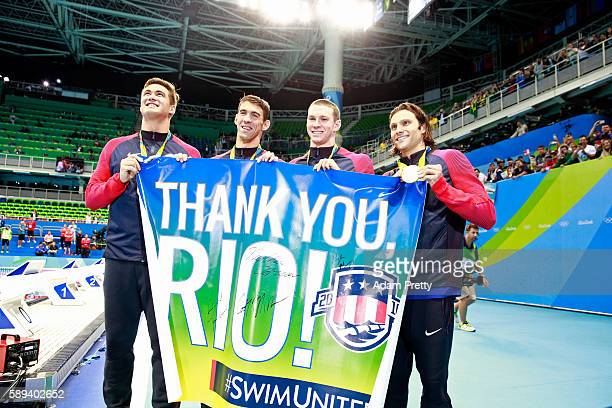Gold medalists Nathan Adrian Michael Phelps Ryan Murphy and Cody Miller of the United States thank the crowd during the medal ceremony for the Men's...