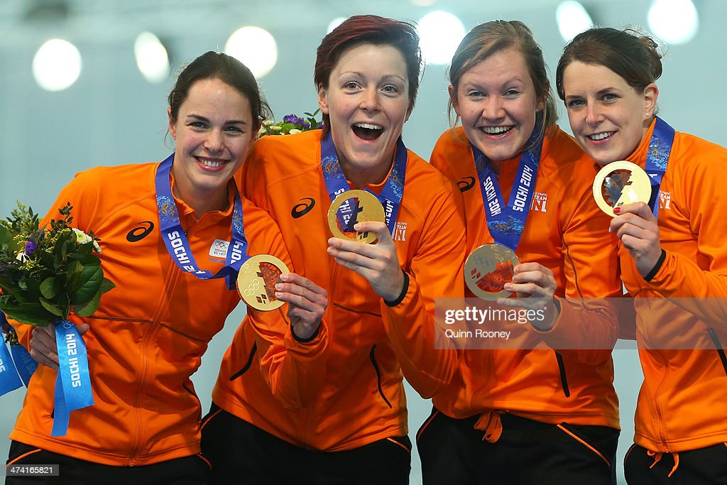 Gold medalists Netherlands celebrate on the podium during the medal ceremony for the Speed Skating Women's Pursuit on day fifteen of the Sochi 2014 Winter Olympics at at Adler Arena Skating Center on February 22, 2014 in Sochi, Russia.