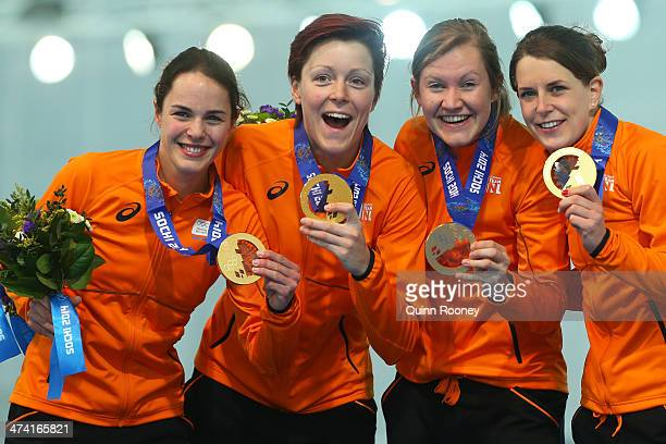 Gold medalists Netherlands celebrate on the podium during the medal ceremony for the Speed Skating Women's Pursuit on day fifteen of the Sochi 2014...