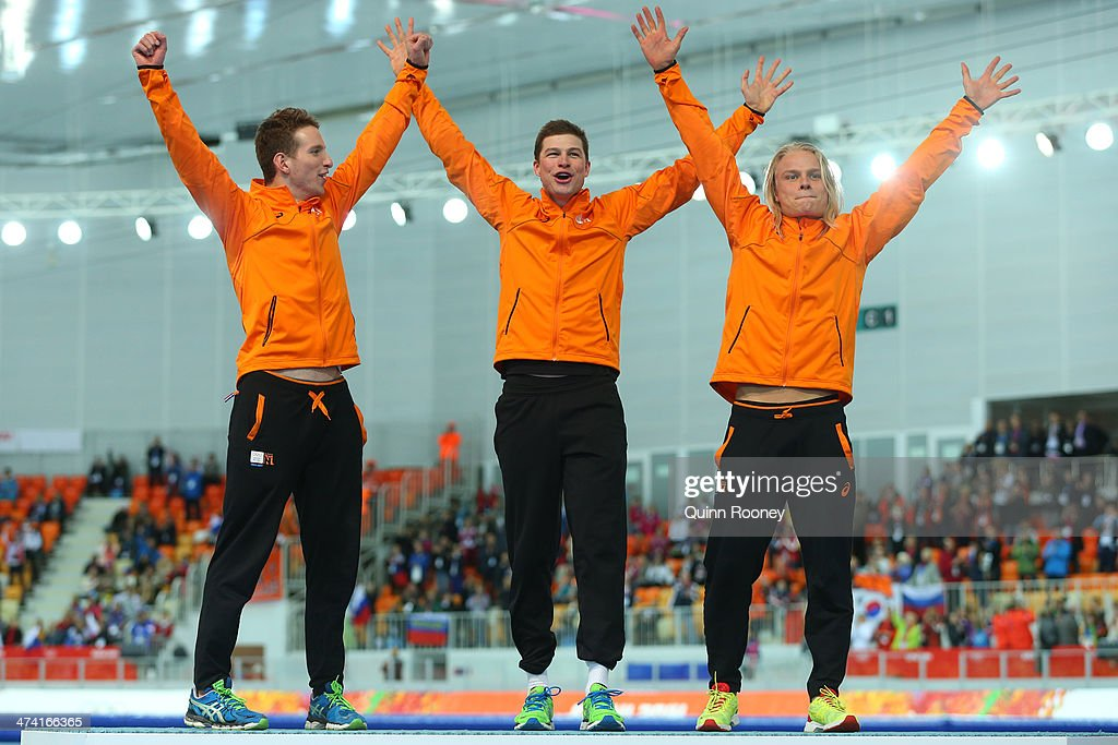 Gold medalists Netherlands celebrate on the podium during the medal ceremony for the Speed Skating Men's Team Pursuit on day fifteen of the Sochi 2014 Winter Olympics at at Adler Arena Skating Center on February 22, 2014 in Sochi, Russia.