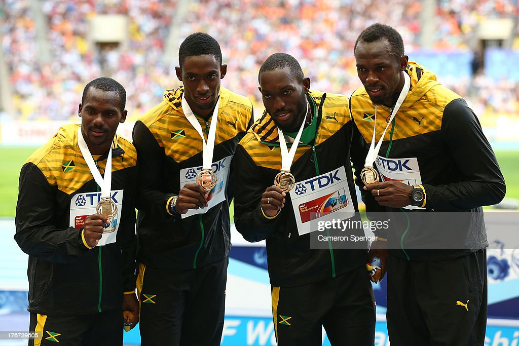 Gold medalists <a gi-track='captionPersonalityLinkClicked' href=/galleries/search?phrase=Nickel+Ashmeade&family=editorial&specificpeople=4401503 ng-click='$event.stopPropagation()'>Nickel Ashmeade</a>, <a gi-track='captionPersonalityLinkClicked' href=/galleries/search?phrase=Nesta+Carter+-+Sprinter&family=editorial&specificpeople=4335396 ng-click='$event.stopPropagation()'>Nesta Carter</a>, <a gi-track='captionPersonalityLinkClicked' href=/galleries/search?phrase=Kemar+Bailey-Cole&family=editorial&specificpeople=5964346 ng-click='$event.stopPropagation()'>Kemar Bailey-Cole</a>, and <a gi-track='captionPersonalityLinkClicked' href=/galleries/search?phrase=Usain+Bolt&family=editorial&specificpeople=604196 ng-click='$event.stopPropagation()'>Usain Bolt</a> of Jamaica pose on the podium during the medal ceremony for the Men's 4x100 relay during Day Nine of the 14th IAAF World Athletics Championships Moscow 2013 at Luzhniki Stadium on August 18, 2013 in Moscow, Russia.