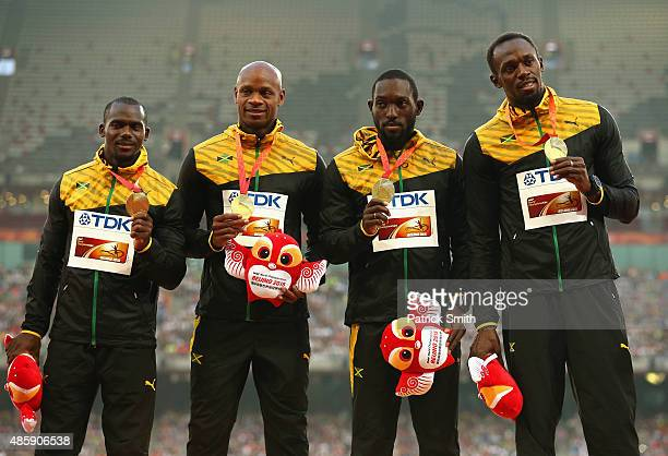 Gold medalists Nickel Ashmeade of Jamaica Asafa Powell of Jamaica Usain Bolt of Jamaica and Nesta Carter of Jamaica pose on the podium during the...