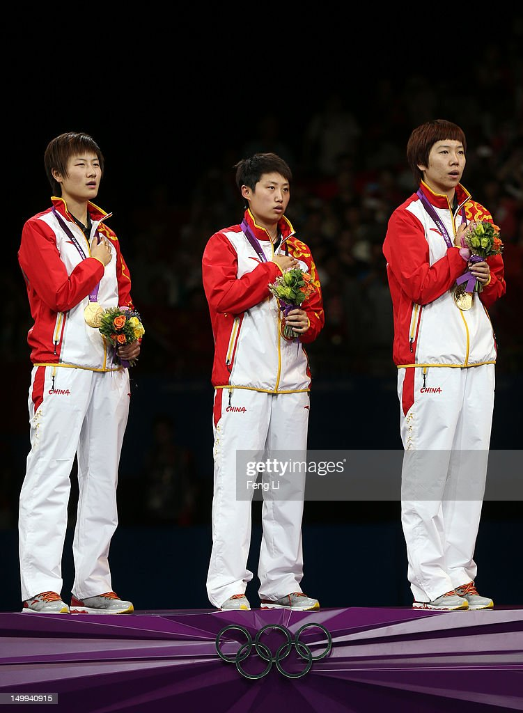 Gold medalists Ning Ding, Yue Guo and Xiaoxia Li of China pose on the podium during the medal ceremony for the Women's Team Table Tennis on Day 11 of the London 2012 Olympic Games at ExCeL on August 7, 2012 in London, England.
