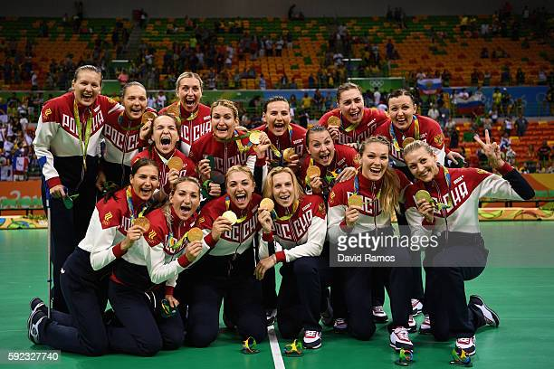 Gold medalists of Russia pose following the medal ceremony for the Women's Handball contest at Future Arena on Day 15 of the Rio 2016 Olympic Games...