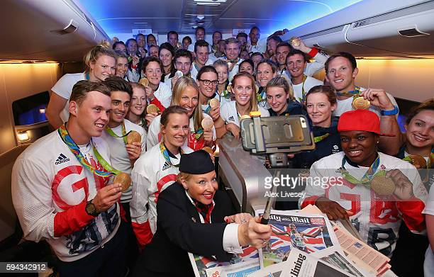 Gold medalists of Team GB pose for a selfie with a member of British Airways cabin crew prior to flying back from Rio on British Airways flight...