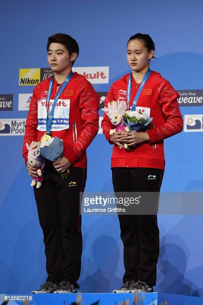 Gold medalists Qian Ren and Yajie Si of China pose with the medals won during the Women's Diving 10M Synchro Platform final on day three of the...