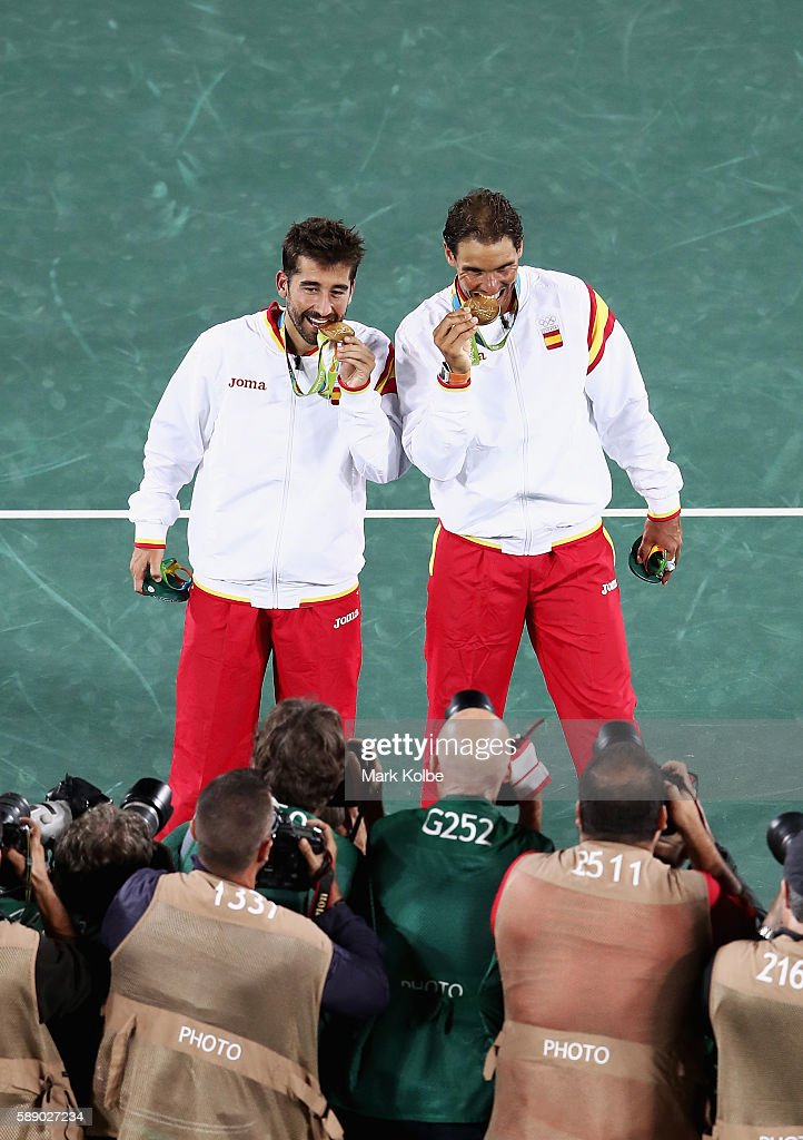 Gold medalists Rafael Nadal and Marc Lopez of Spain celebrate after the Men's Doubles competition on Day 7 of the Rio 2016 Olympic Games at the Olympic Tennis Centre on August 12, 2016 in Rio de Janeiro, Brazil.