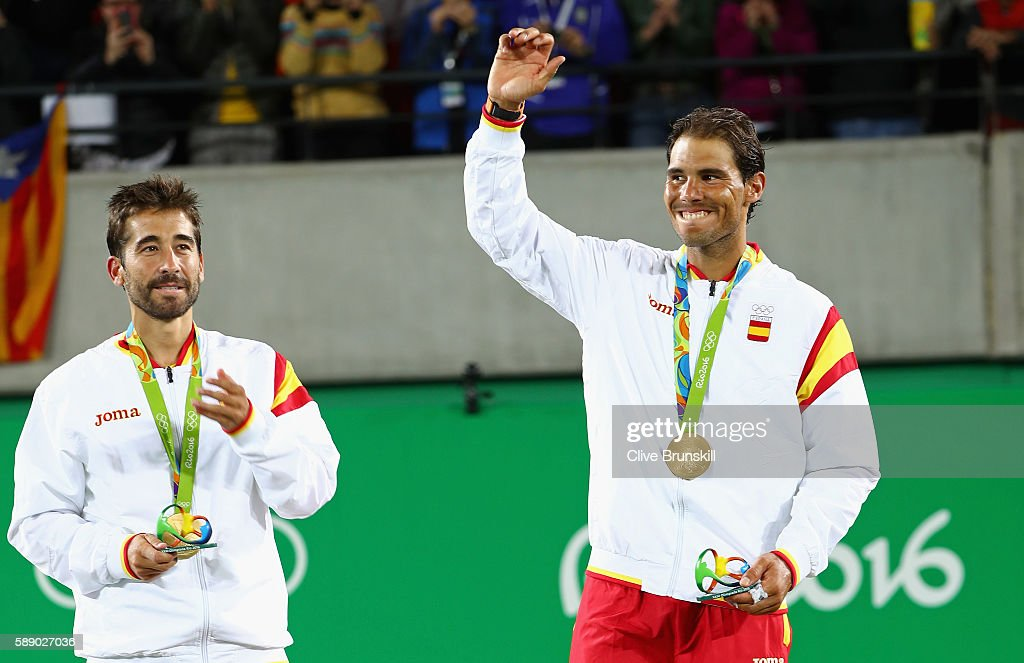 Gold medalists Rafael Nadal and Marc Lopez of Spain celebrate on the podium after the Men's Doubles competition on Day 7 of the Rio 2016 Olympic Games at the Olympic Tennis Centre on August 12, 2016 in Rio de Janeiro, Brazil.