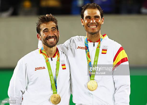 Gold medalists Rafael Nadal and Marc Lopez of Spain celebrate on the podium after the Men's Doubles competition on Day 7 of the Rio 2016 Olympic...