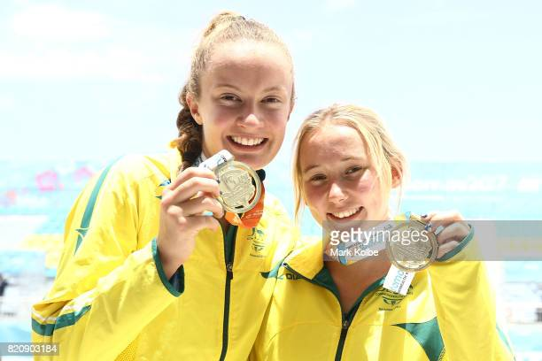 Gold medalists Rebecca Ingram and Carrie Van Rensburg of Australia pose after the medal presentation for the girl's beach volleyball on day 5 of the...