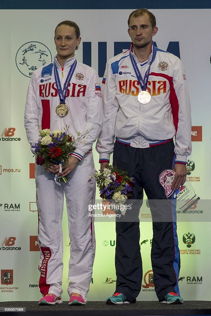 Gold medalists Rimsaite Donata and Lesun Aleksander from Russia during celebration ceremony at the mixed relay World Championship in modern pentathlon in Moscow in Olympic Sports Complex in Moscow, Russia, on May 29, 2016.