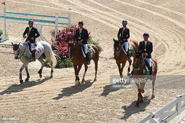 Gold medalists Roger Yves Bost of France riding Sydney Une Prince Penelope Leprevost of France riding Flora de Mariposa Kevin Staut of France riding...