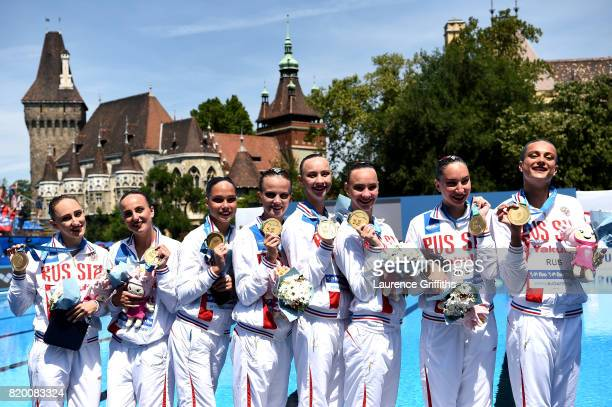 Gold medalists Russia pose with the medals won during the Synchronised Swimming Team Free final on day eight of the Budapest 2017 FINA World...