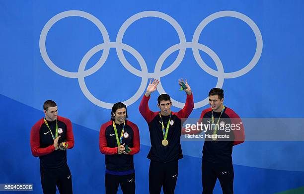 Gold medalists Ryan Murphy Cody Miller Michael Phelps and Nathan Adrian of the United States celebrate on the podium during the medal ceremony for...