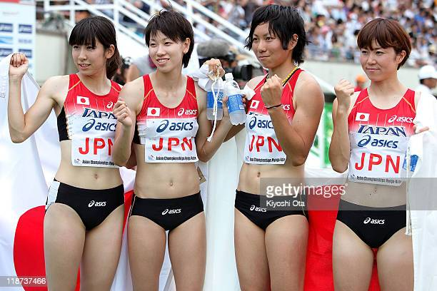 Gold medalists Saori Imai Chisato Fukushima Momoko Takahashi and Nao Okabe of Japan celebrate after the Women's 4x100m Relay final during the day...