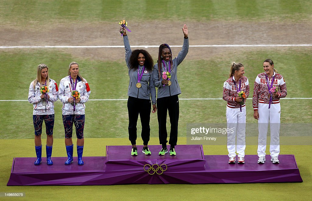 Gold medalists <a gi-track='captionPersonalityLinkClicked' href=/galleries/search?phrase=Serena+Williams+-+Tennis+Player&family=editorial&specificpeople=171101 ng-click='$event.stopPropagation()'>Serena Williams</a> of the United States and <a gi-track='captionPersonalityLinkClicked' href=/galleries/search?phrase=Venus+Williams&family=editorial&specificpeople=171981 ng-click='$event.stopPropagation()'>Venus Williams</a> of the United States (C), silver medalists <a gi-track='captionPersonalityLinkClicked' href=/galleries/search?phrase=Lucie+Hradecka&family=editorial&specificpeople=4882302 ng-click='$event.stopPropagation()'>Lucie Hradecka</a> of Czech Republic and <a gi-track='captionPersonalityLinkClicked' href=/galleries/search?phrase=Andrea+Hlavackova&family=editorial&specificpeople=3378910 ng-click='$event.stopPropagation()'>Andrea Hlavackova</a> of Czech Republic and bronze medalists <a gi-track='captionPersonalityLinkClicked' href=/galleries/search?phrase=Maria+Kirilenko&family=editorial&specificpeople=211512 ng-click='$event.stopPropagation()'>Maria Kirilenko</a> of Russia and <a gi-track='captionPersonalityLinkClicked' href=/galleries/search?phrase=Nadia+Petrova&family=editorial&specificpeople=178321 ng-click='$event.stopPropagation()'>Nadia Petrova</a> of Russia during the medal ceremony for the Women's Doubles Tennis on Day 9 of the London 2012 Olympic Games at the All England Lawn Tennis and Croquet Club on August 5, 2012 in London, England.