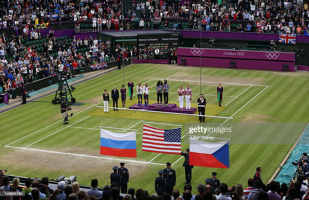 Gold medalists <a gi-track='captionPersonalityLinkClicked' href=/galleries/search?phrase=Serena+Williams+-+Tennis+Player&family=editorial&specificpeople=171101 ng-click='$event.stopPropagation()'>Serena Williams</a> of the United States and <a gi-track='captionPersonalityLinkClicked' href=/galleries/search?phrase=Venus+Williams&family=editorial&specificpeople=171981 ng-click='$event.stopPropagation()'>Venus Williams</a> of the United States (C), silver medalists <a gi-track='captionPersonalityLinkClicked' href=/galleries/search?phrase=Lucie+Hradecka&family=editorial&specificpeople=4882302 ng-click='$event.stopPropagation()'>Lucie Hradecka</a> of Czech Republic and <a gi-track='captionPersonalityLinkClicked' href=/galleries/search?phrase=Andrea+Hlavackova&family=editorial&specificpeople=3378910 ng-click='$event.stopPropagation()'>Andrea Hlavackova</a> of Czech Republic (L) and bronze medalists <a gi-track='captionPersonalityLinkClicked' href=/galleries/search?phrase=Maria+Kirilenko&family=editorial&specificpeople=211512 ng-click='$event.stopPropagation()'>Maria Kirilenko</a> of Russia and <a gi-track='captionPersonalityLinkClicked' href=/galleries/search?phrase=Nadia+Petrova&family=editorial&specificpeople=178321 ng-click='$event.stopPropagation()'>Nadia Petrova</a> of Russia during the medal ceremony for the Women's Doubles Tennis on Day 9 of the London 2012 Olympic Games at the All England Lawn Tennis and Croquet Club on August 5, 2012 in London, England.