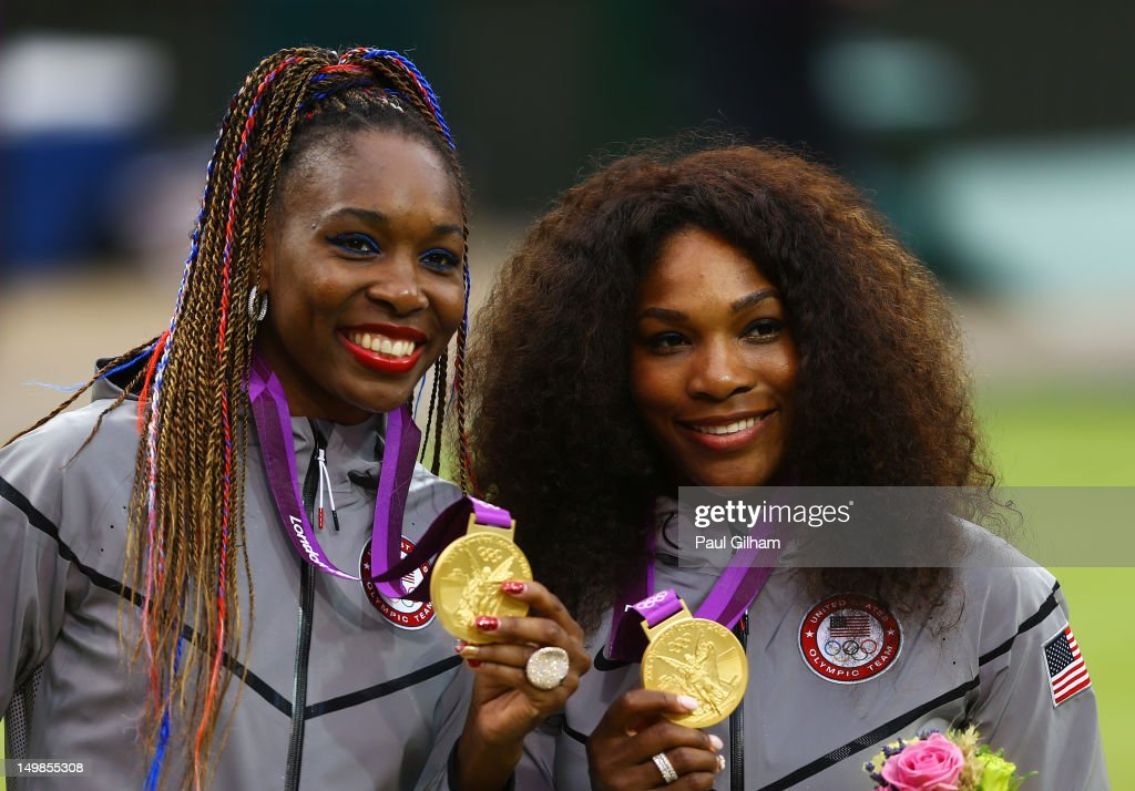 Gold medalists <a gi-track='captionPersonalityLinkClicked' href=/galleries/search?phrase=Serena+Williams&family=editorial&specificpeople=171101 ng-click='$event.stopPropagation()'>Serena Williams</a> of the United States and <a gi-track='captionPersonalityLinkClicked' href=/galleries/search?phrase=Venus+Williams&family=editorial&specificpeople=171981 ng-click='$event.stopPropagation()'>Venus Williams</a> of the United States celebrate on the popdium during the medal ceremony for the Women's Doubles Tennis on Day 9 of the London 2012 Olympic Games at the All England Lawn Tennis and Croquet Club on August 5, 2012 in London, England.