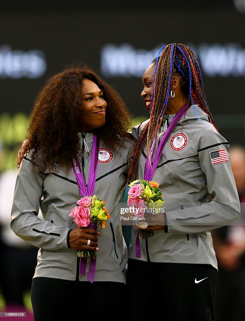 Gold medalists <a gi-track='captionPersonalityLinkClicked' href=/galleries/search?phrase=Serena+Williams+-+Tennis+Player&family=editorial&specificpeople=171101 ng-click='$event.stopPropagation()'>Serena Williams</a> of the United States and <a gi-track='captionPersonalityLinkClicked' href=/galleries/search?phrase=Venus+Williams&family=editorial&specificpeople=171981 ng-click='$event.stopPropagation()'>Venus Williams</a> of the United States celebrate on the popdium during the medal ceremony for the Women's Doubles Tennis on Day 9 of the London 2012 Olympic Games at the All England Lawn Tennis and Croquet Club on August 5, 2012 in London, England.