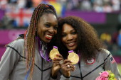 Gold medalists Serena Williams of the United States and Venus Williams of the United States celebrate during the medal ceremony for the Women's...