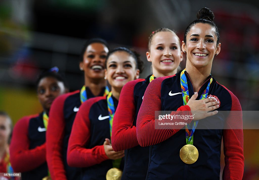 Gold Medalists Simone Biles, Gabrielle Douglas, Lauren Hernandez, Madison Kocian and Alexandra Raisman of the United States stand on the podium for the national anthem at the medal ceremony for the Artistic Gymnastics Women's Team Final on Day 4 of the Rio 2016 Olympic Games at the Rio Olympic Arena on August 9, 2016 in Rio de Janeiro, Brazil.