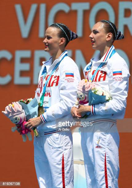 Gold medalists Svetlana Kolesnichenko and Alexandra Patskevich of Russia pose with the medals won during the Synchronised Swimming DuetFree final on...