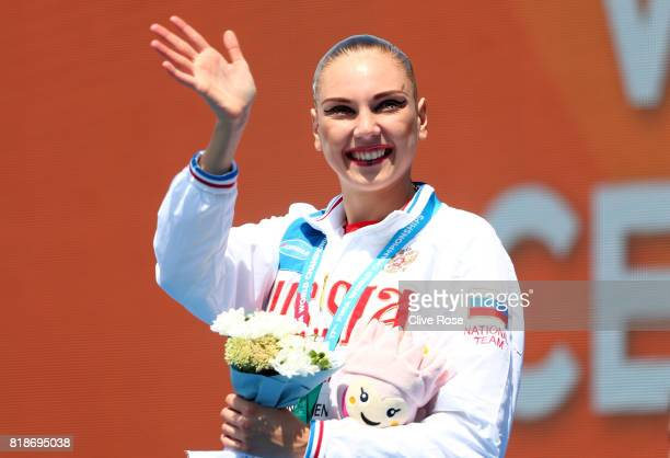 Gold medalists Svetlana Kolesnichenko of Russia poses with the medal won during the Synchronised Swimming Solo Free Final on day six of the Budapest...
