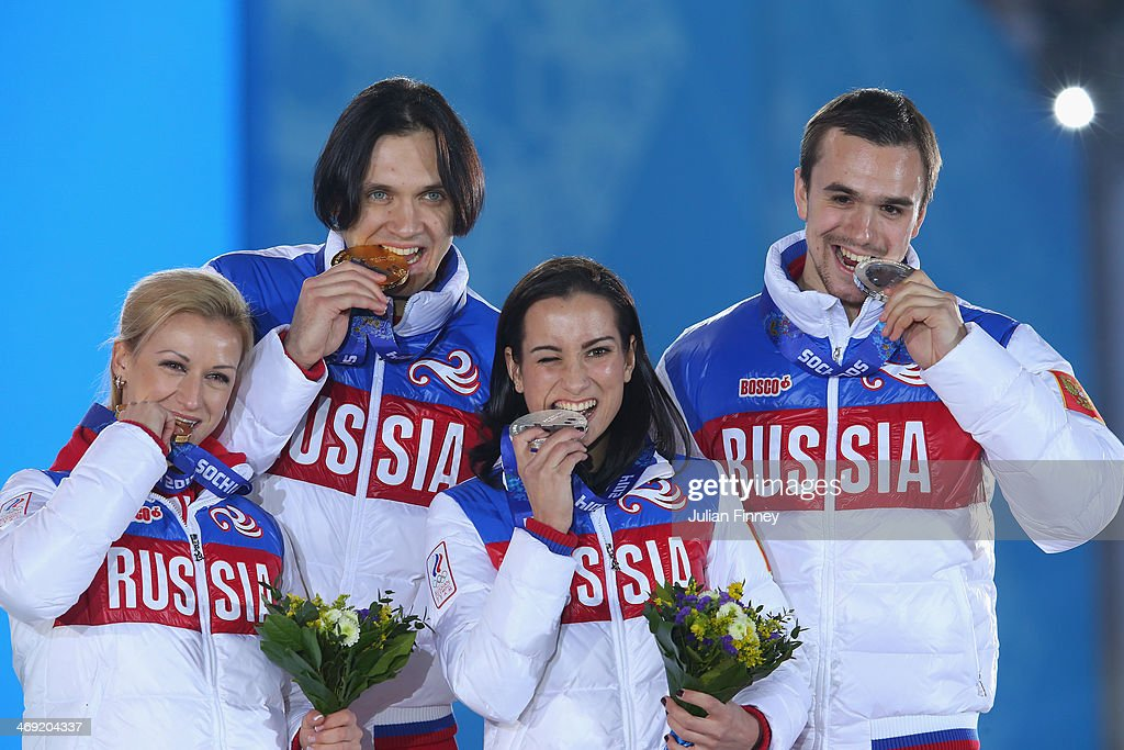Gold medalists <a gi-track='captionPersonalityLinkClicked' href=/galleries/search?phrase=Tatiana+Volosozhar&family=editorial&specificpeople=798077 ng-click='$event.stopPropagation()'>Tatiana Volosozhar</a> and <a gi-track='captionPersonalityLinkClicked' href=/galleries/search?phrase=Maxim+Trankov&family=editorial&specificpeople=798054 ng-click='$event.stopPropagation()'>Maxim Trankov</a> of Russia and silver medalists <a gi-track='captionPersonalityLinkClicked' href=/galleries/search?phrase=Ksenia+Stolbova&family=editorial&specificpeople=7338286 ng-click='$event.stopPropagation()'>Ksenia Stolbova</a> and <a gi-track='captionPersonalityLinkClicked' href=/galleries/search?phrase=Fedor+Klimov&family=editorial&specificpeople=7338285 ng-click='$event.stopPropagation()'>Fedor Klimov</a> of Russia celebrate during the medal ceremony for the Figure Skating Pairs Free Skating on day six of the Sochi 2014 Winter Olympics at Medals Plaza on February 13, 2014 in Sochi, Russia.