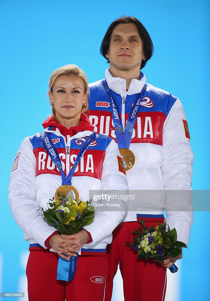 Gold medalists <a gi-track='captionPersonalityLinkClicked' href=/galleries/search?phrase=Tatiana+Volosozhar&family=editorial&specificpeople=798077 ng-click='$event.stopPropagation()'>Tatiana Volosozhar</a> and <a gi-track='captionPersonalityLinkClicked' href=/galleries/search?phrase=Maxim+Trankov&family=editorial&specificpeople=798054 ng-click='$event.stopPropagation()'>Maxim Trankov</a> of Russia celebrate during the medal ceremony for the Figure Skating Pairs Free Skating on day six of the Sochi 2014 Winter Olympics at Medals Plaza on February 13, 2014 in Sochi, Russia.