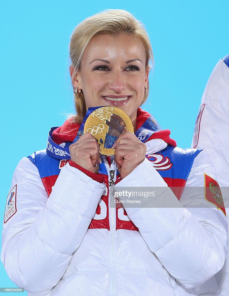Gold medalists <a gi-track='captionPersonalityLinkClicked' href=/galleries/search?phrase=Tatiana+Volosozhar&family=editorial&specificpeople=798077 ng-click='$event.stopPropagation()'>Tatiana Volosozhar</a> of Russia celebrates during the medal ceremony for the Figure Skating Pairs Free Skating on day six of the Sochi 2014 Winter Olympics at Medals Plaza on February 13, 2014 in Sochi, Russia.