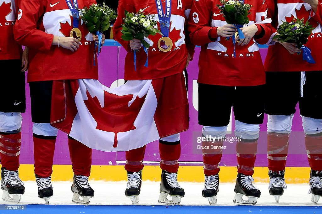 Gold medalists Team Canada celebrate during the medal ceremony after defeating the United States 3-2 in overtime during the Ice Hockey Women's Gold Medal Game on day 13 of the Sochi 2014 Winter Olympics at Bolshoy Ice Dome on February 20, 2014 in Sochi, Russia.