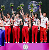 Gold medalists Team Japan celebrate on the podium at the medal ceremony for the Men's Team during day six of World Artistic Gymnastics Championship...