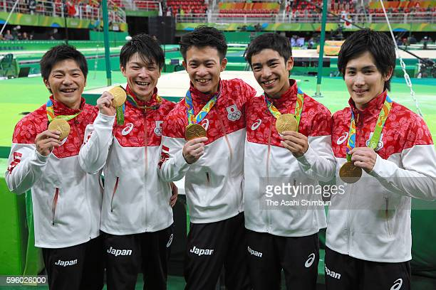 Gold medalists team Japan member Koji Yamamuro Kohei Uchimura Yusuke Tanaka Kenzo Shirai and Ryohei Kato of Japan celebrate after the medal ceremony...